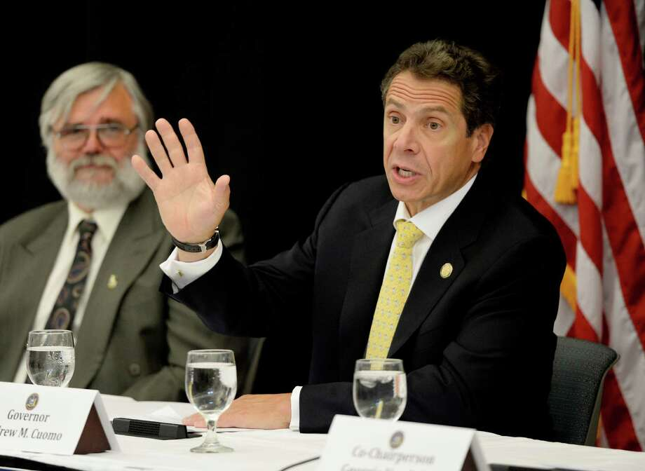 Governor Andrew Cuomo speaks at SUNY Cobelskill Tuesday afternoon, Sept. 10, 2013, where he addressed local politicians and interested parties about funding available for rebuilding storm ravaged areas in Schoharie County in Cobelskill, N.Y. Schoharie Town Supervisor James Buzon is pictured left. (Skip Dickstein/Times Union) Photo: SKIP DICKSTEIN / 00023817A