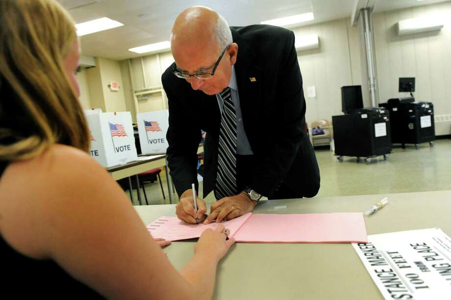Michael Zurlo, Republican candidate for Saratoga County sheriff, signs in to vote on Tuesday, Sept. 10, 2013, at Stillwater Town Hall in Stillwater, N.Y. (Cindy Schultz / Times Union) Photo: Cindy Schultz / 00023804B