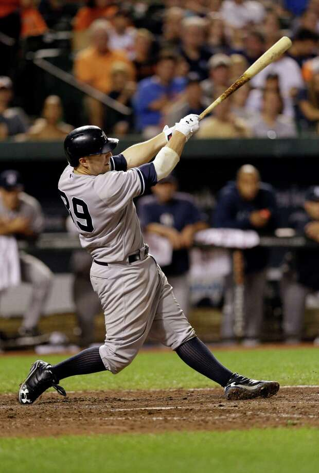New York Yankees' Mark Reynolds doubles in the eighth inning of a baseball game against the Baltimore Orioles, Tuesday, Sept. 10, 2013, in Baltimore. Curtis Granderson scored on the play, and New York won 7-5. (AP Photo/Patrick Semansky) ORG XMIT: MDPS112 Photo: Patrick Semansky / AP