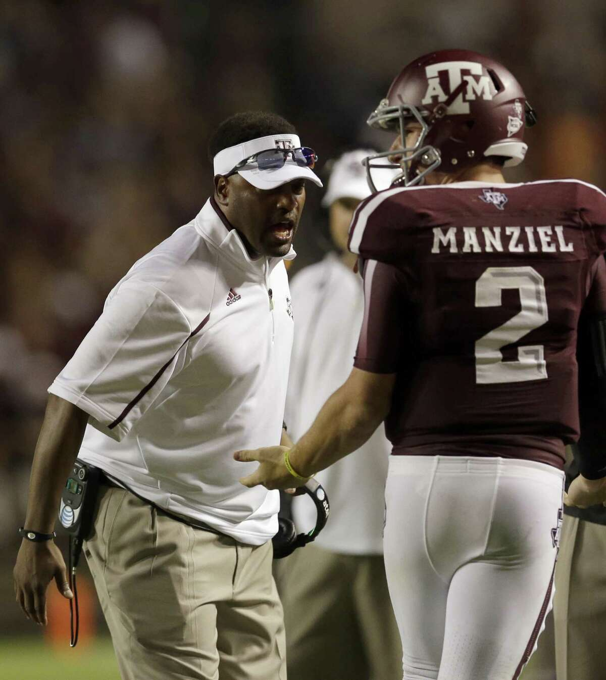 Texas A&M coach Kevin Sumlin (left) says quarterback Johnny Manziel was advised not to talk to the media this week by family, advisers and lawyers.