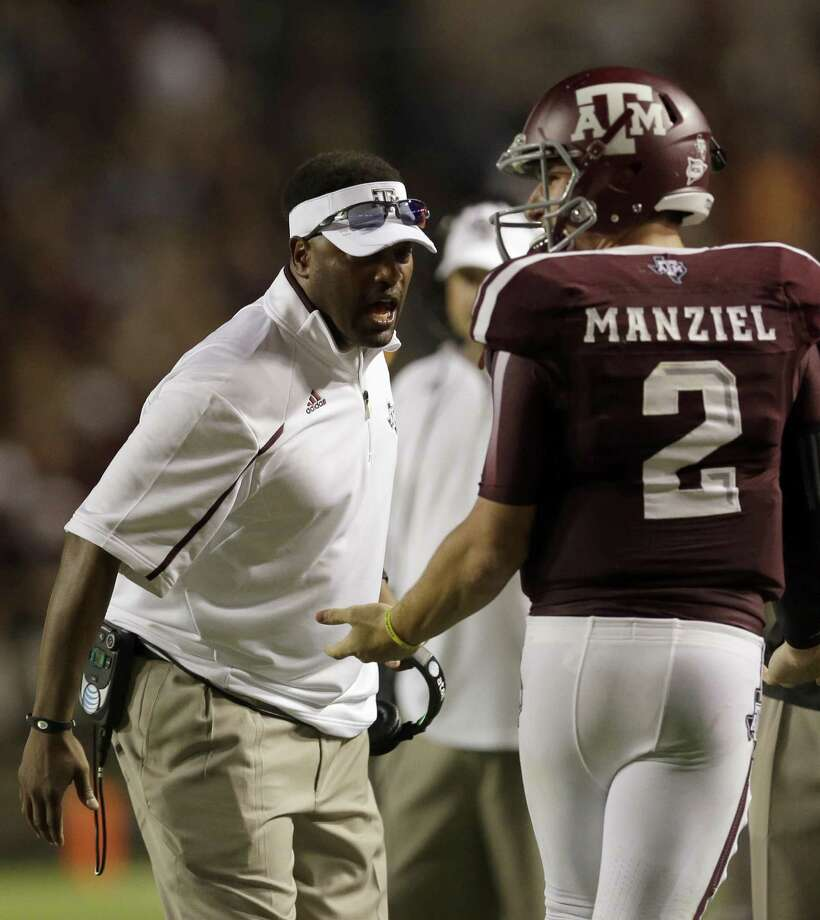 Texas A&M coach Kevin Sumlin (left) says quarterback Johnny Manziel was advised not to talk to the media this week by family, advisers and lawyers. Photo: David J. Phillip /Associated Press
