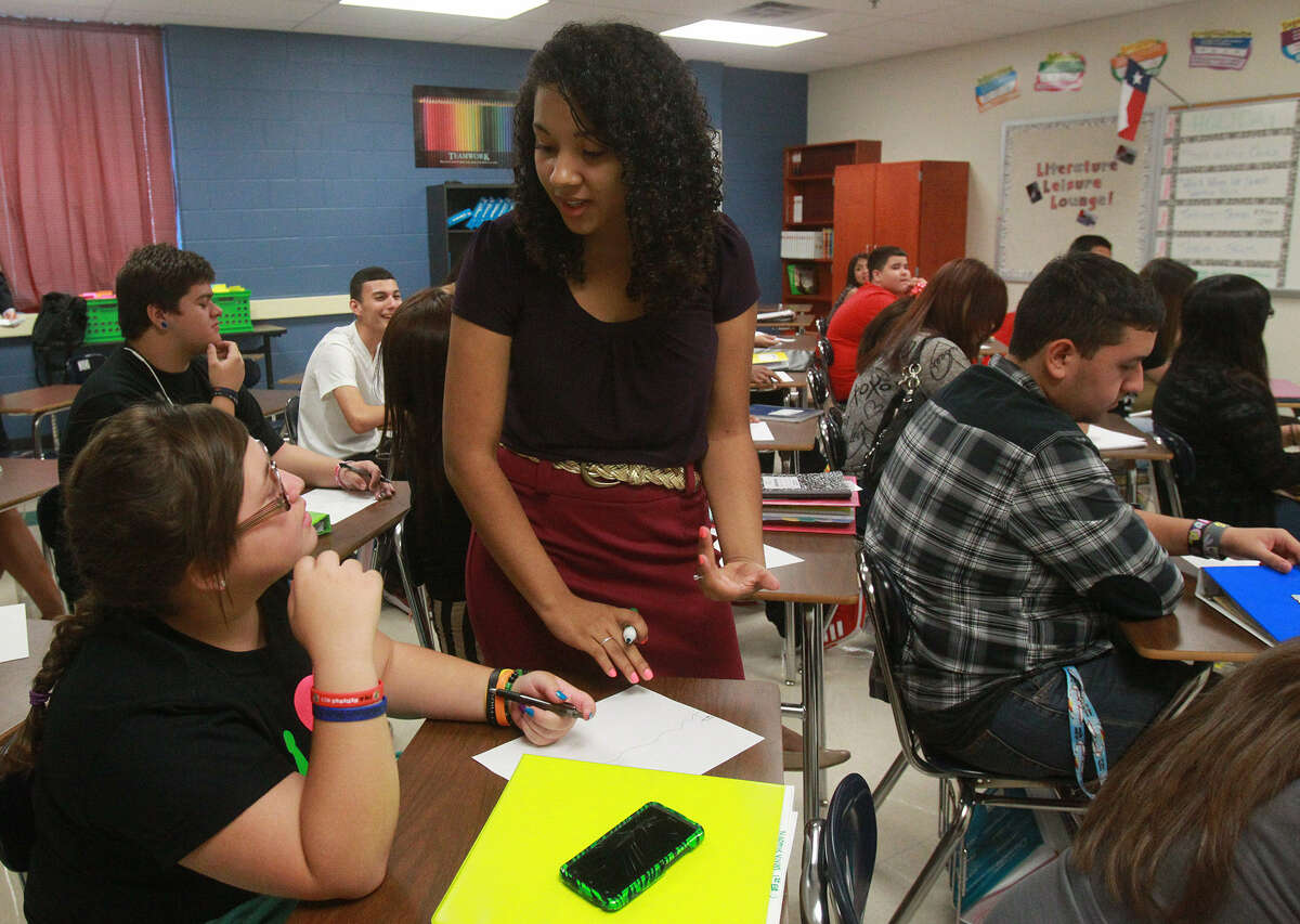 Ashley Garcia (standing), a 2009 graduate of Stevens High School, now is teaching English classes there.