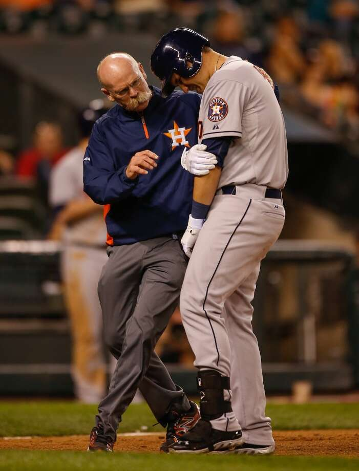 Brandon Laird #4 of the Astros is tended to by a trainer after being hit by a pitch. Photo: Otto Greule Jr, Getty Images