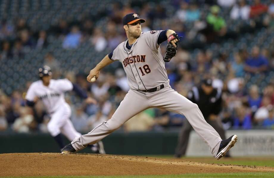 Astros starting pitcher Jordan Lyles throws against the Mariners. Photo: Ted S. Warren, Associated Press