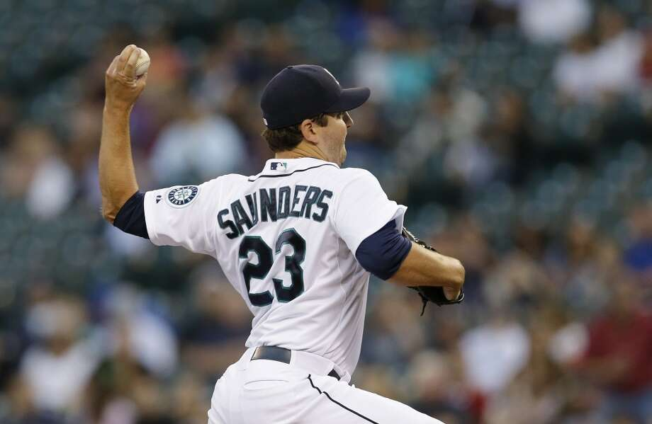 Mariners starting pitcher Joe Saunders throws against the Astros. Photo: Ted S. Warren, Associated Press