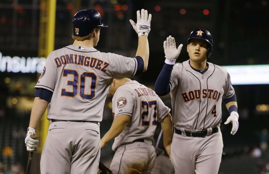 Brandon Laird, right, greets Matt Dominguez (30) at the plate after Laird hit a two-run home run. Photo: Ted S. Warren, Associated Press