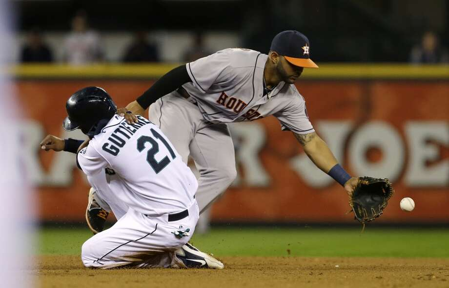 Franklin Gutierrez is safe at second base on a ground out by Justin Smoak as Astros Houston Astros shortstop Jonathan Villar can't catch the throw from first baseman Brandon Laird. Photo: Ted S. Warren, Associated Press