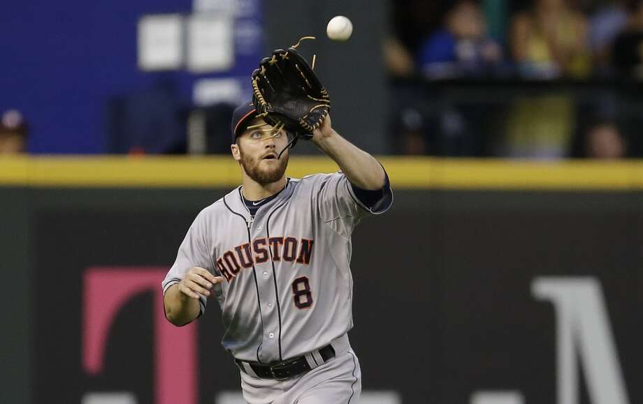 Astros left fielder Trevor Crowe catches a fly ball hit by Mariners' Kendrys Morales. Photo: Ted S. Warren, Associated Press