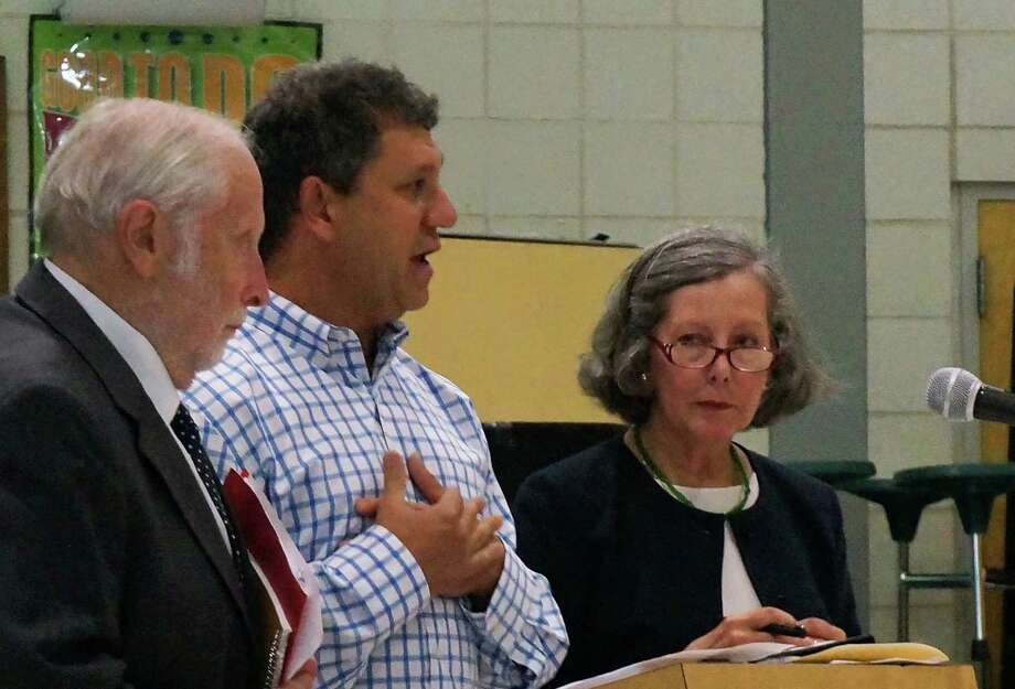 Discussing plans to open a medical marijuana dispensary at 222 Post Road during Tuesday's meeting of the Town Plan and Zoning Commission were, from left, pharmacist Robert Tender, applicant David Lipton and lawyer Diane Whitney.  FAIRFIELD CITIZEN, CT 9/10/13 Photo: Genevieve Reilly / Fairfield Citizen