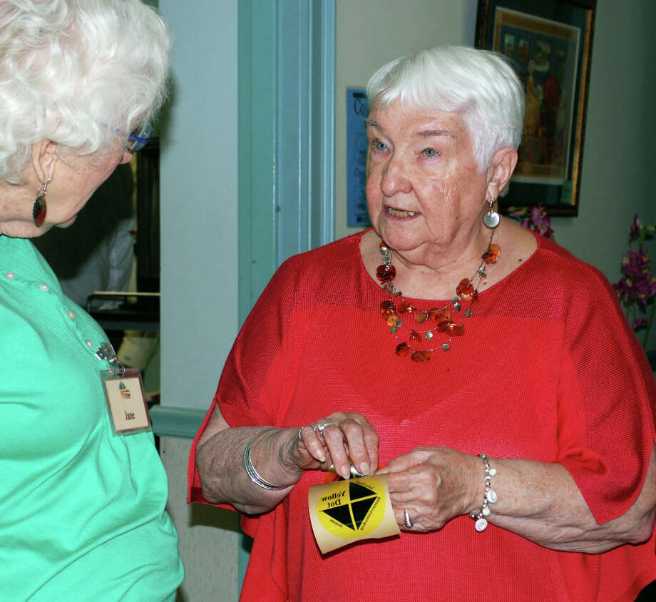 Jane Peterson, left, a member of New Milford Triad, and Carolyn Critelli, a member of the New Milford Senior Center Advisory Board, discuss the Yellow Dot program during a senior safety day hosted by Triad at the New Milford Senior Center. Aug. 23, 2013. The program is designed to provide first responders the information critical to oneís treatment following an automobile accident or medical emergency. Photo: Deborah Rose