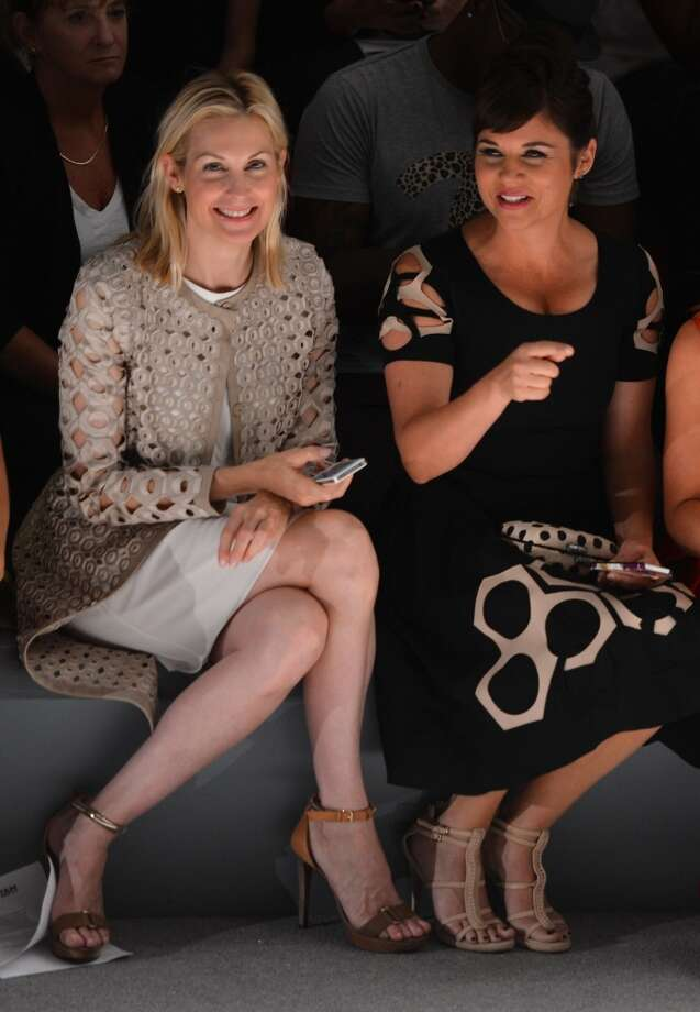 Actress Kelly Rutherford (L) and actress Tiffani Thiessen (R) attend the Vivienne Tam fashion show during Mercedes-Benz Fashion Week Spring 2014 at The Stage at Lincoln Center on September 8, 2013 in New York City. Photo: Stephen Lovekin, Getty Images For Mercedes-Benz Fashion Week Spring 2014