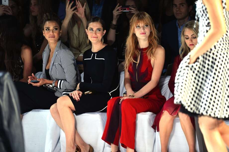 (L-R) Jessica Alba, Allison Williams and Bella Thorne attend the Diane Von Furstenberg fashion show during Mercedes-Benz Fashion Week Spring 2014 at The Theatre at Lincoln Center on September 8, 2013 in New York City. Photo: Stephen Lovekin, Getty Images For Mercedes-Benz Fashion Week Spring 2014