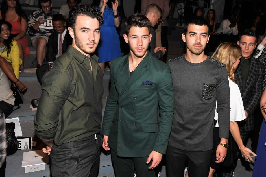 (L-R) Kevin Jonas, Nick Jonas and Joe Jonas attend the Richard Chai Spring 2014 fashion show during Mercedes-Benz Fashion Week at The Stage at Lincoln Center on September 5, 2013 in New York City. Photo: Stephen Lovekin, Getty Images For Mercedes-Benz Fashion Week