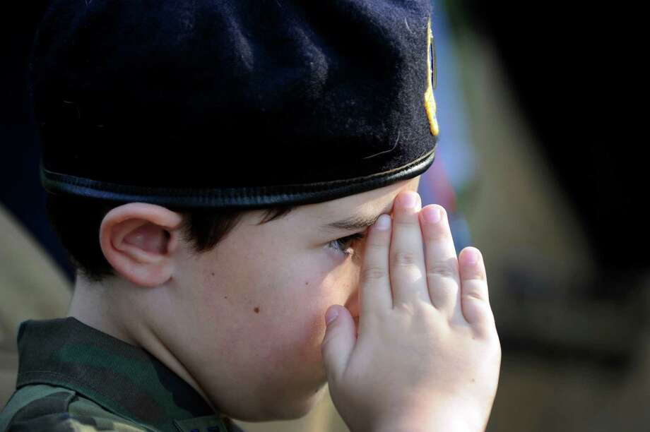 Steven Johnston, 9, of New Fairfield, salutes during an annual memorial service to honor the victims of 9/11, held on the property of Howard Lasher in Newtown, Conn., Wednesday, Sept. 11, 2013. Lasher lost nine close friends and associates in the terrorist attack on the World Trade Center in 2001. Photo: Carol Kaliff / The News-Times