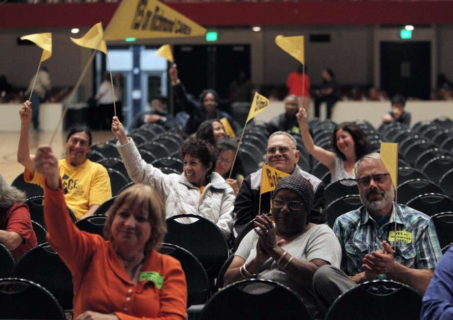 A few dozen citizens and suporters of the eminent domain measure cheered after the measure passed during a city council meeting on Tuesday, September 10, 2013, in Richmond, Calif. Photo: Carlos Avila Gonzalez, The Chronicle