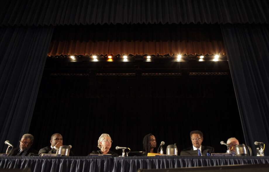 Richmond city councilmembers sit under the lights at the Richmond Auditorium during a city council meeting on Tuesday, September 10, 2013, in Richmond, Calif. Photo: Carlos Avila Gonzalez, The Chronicle