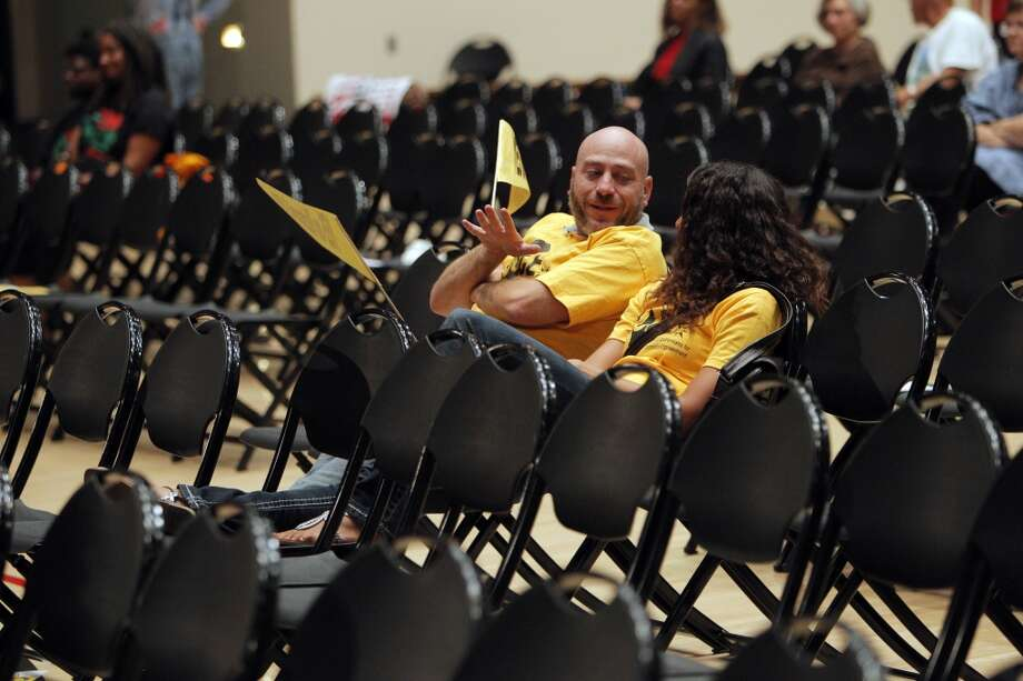 Jeff Ordower and Christina Livingston were a few of the final few dozen people in attendance when the eminent domain measure finally came up for a vote during a city council meeting on Tuesday, September 10, 2013, in Richmond, Calif. Photo: Carlos Avila Gonzalez, The Chronicle