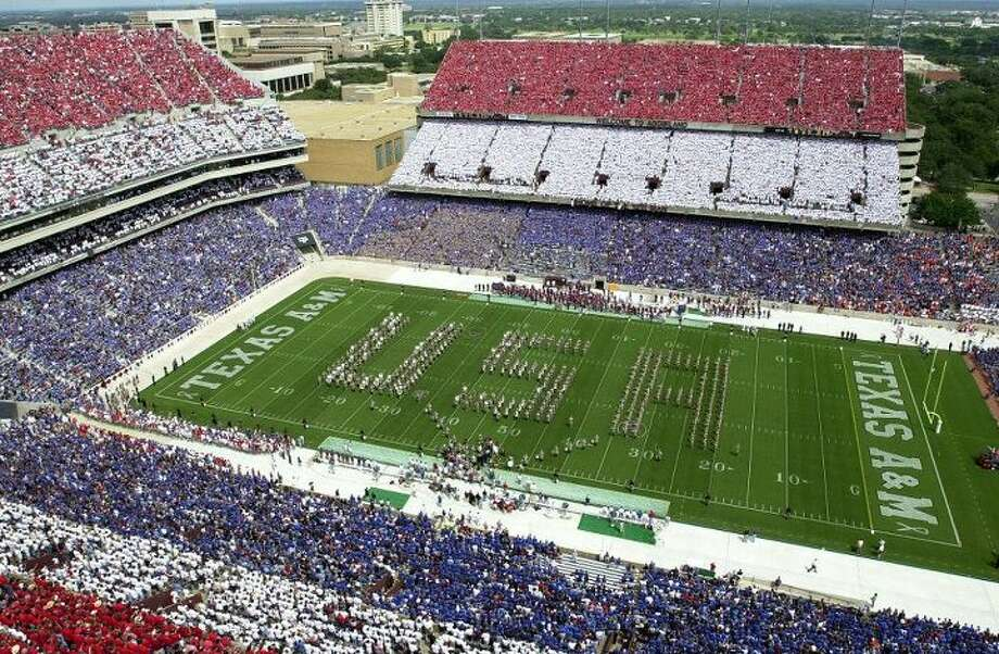 Sept. 22, 2001 - Students and football fans at Texas A&M University and Oklahoma State University wore red, white, and blue to pay tribute to those who were lost in the the 9/11 terrorist attack. Five A&M students coordinated the sale of t-shirts with colors assigned by seat, and approximately $180,000 was raised for the New York Fire and Police relief funds. Photo: Texas A&M University