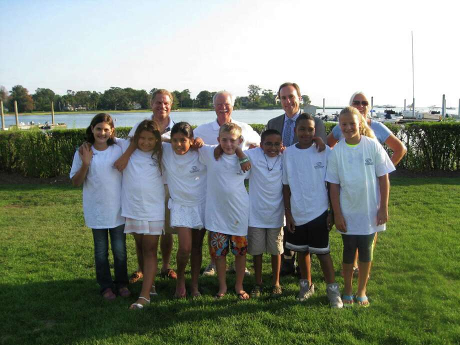 On hand for the recent graduation of this year's Young Mariners of Greenwich, hosted by Riverside Yacht Club were: back from left, Ty Anderson, Commodore of Riverside Yacht Club; Tom OíConnell, Founder of Young Mariners of Greenwich; Peter Tesei, First Selectman; and Dawn Berrocal, Liaison between students and Boys and Girls Club. Front row from left are Young Mariners Hannah Villaneava, Nicole Martins, Suzeth Diaz, Justin Sawyer, Carlos Flores, Jordan Ysaac and Chloe Smith. Photo: Contributed Photo