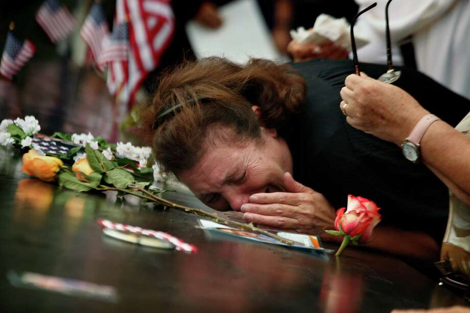 A woman at the National September 11 Memorial, Sunday, Sept. 11, 2011, mourns the loss of her son who died during during attacks at the World Trade Center, Sept. 11, 2001. (AP Photo/Carolyn Cole, Pool) Photo: Carolyn Cole, Associated Press / Los Angeles Times