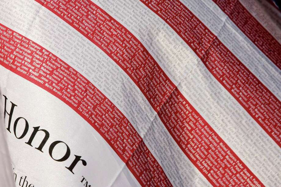 American flags inscribed with the names of the victims of the terrorists attacks of Sept. 11, 2001 fly in Battery Park Friday, Sept. 7, 2007 in New York. (AP Photo/Mary Altaffer) Photo: Mary Altaffer, AP / AP