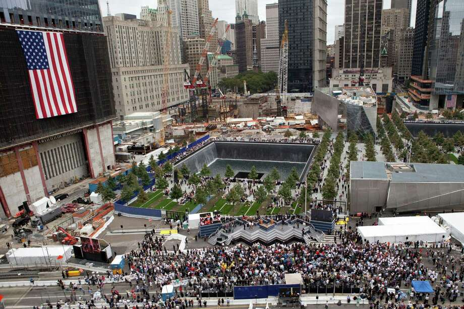 The North Pool of the 9/11 Memorial is seen during the tenth anniversary ceremonies of the September 11, 2001 terrorist attacks at the World Trade Center site, September 11, 2011 in New York City. New York City and the nation are commemorating the tenth anniversary of the terrorist attacks which resulted in the deaths of nearly 3,000 people after two hijacked planes crashed into the World Trade Center, one into the Pentagon in Arlington, Virginia and one crash landed in Shanksville, Pennsylvania.   (Photo by Andrew Burton/Getty Images) Photo: Andrew Burton, Getty / 2011 Getty Images