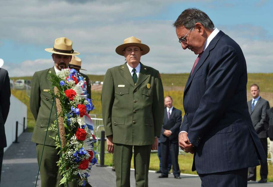 US Defense Secretary Leon Panetta pays his respects after laying a wreath at the Flight 93 National Memorial during ceremonies commemorating the 11th anniversary of the 9/11 attacks in Shanksville, Pennsylvania, on September 10, 2012. AFP PHOTO/Mandel NGAN/POOLMANDEL NGAN/AFP/GettyImages Photo: MANDEL NGAN, AFP/Getty Images / AFP