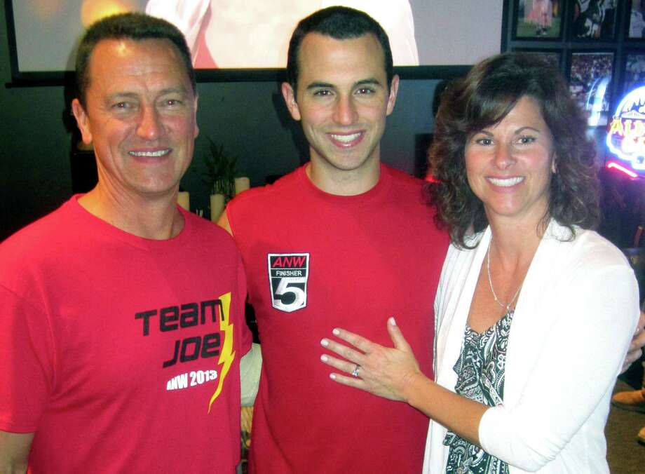 """American Ninja Warrior"" finalist Joe Moravsky of Sherman stands proudly Monday evening with his parents, Joe and Robin Moravsky, in the VIP lounge at 1st and 10 Sports Bar & Grill in New Milford. Moments later, family and friends were among those to look on as his successful run through Stage II of the competition was aired to millions of viewers. Sept. 9, 2013 Photo: Norm Cummings"