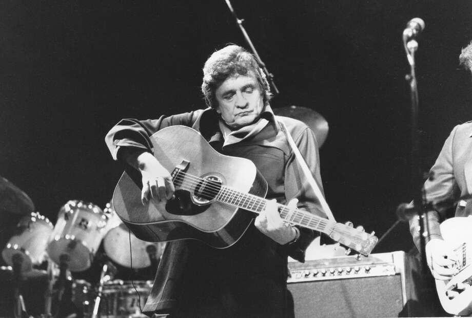 Johnny Cash performs at Radio City Music Hall in New York, in this Feb. 18, 1985, file photo. Photo: RON FREHM, AP / AP