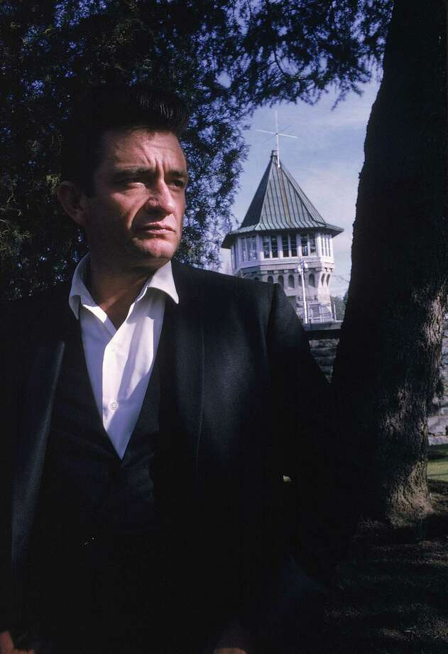 Country singer Johnny Cash poses outside the Folsom Prison in California in this January 13, 1968 file photo. Photo: DAN POUSH, AP / JOHNNY CASH COLLECTION