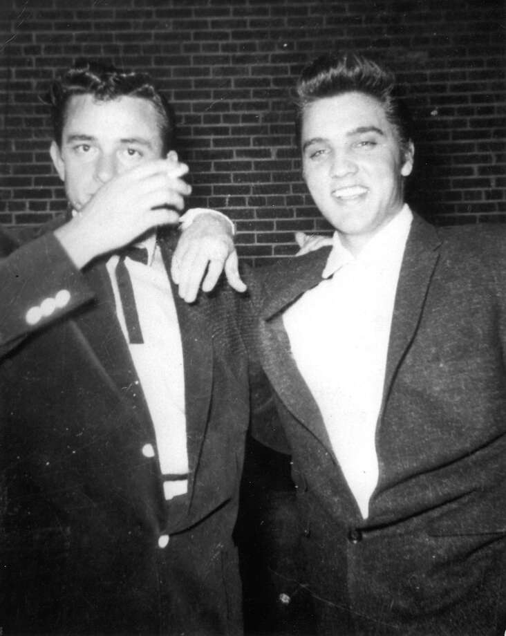 Johnny Cash, left, and Elvis Presley pose together in the early 1950s. Photo: AP / THOMAS NELSON BOOK GROUP