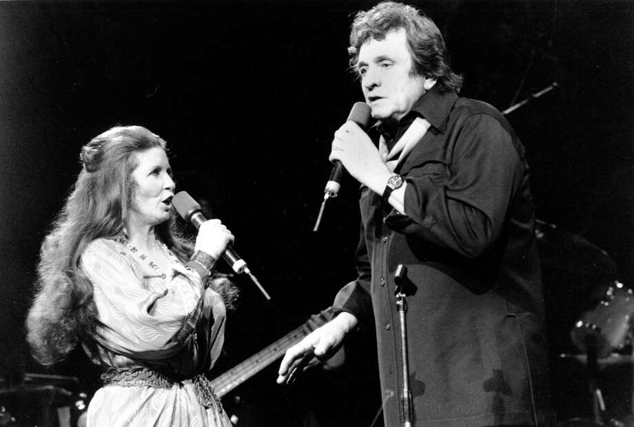 Johnny Cash sings with his wife, June Carter Cash, at Radio City Music Hall in New York City on Feb. 18, 1985. Photo: RON FREHM, AP / AP
