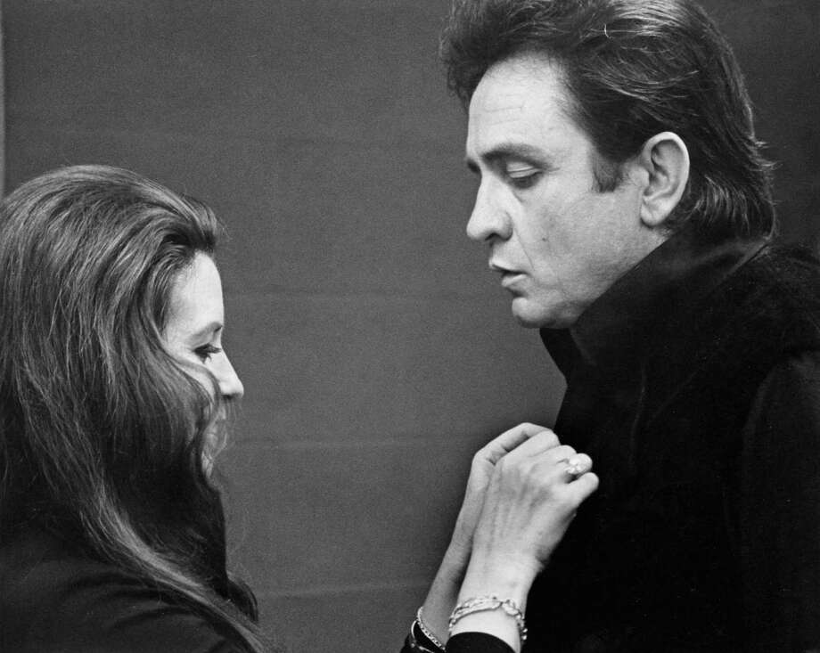 Johnny Cash and wife, June Carter, perform at the Houston Livestock Show and Rodeo on Feb. 28, 1971. They drew 160,475 persons for their six performances, starting Feb. 26. This was 46,749 fewer fans than Elvis Presley drew for the comparable time the last year. Photo: Darrell Davidson, © Houston Chronicle / Houston Chronicle