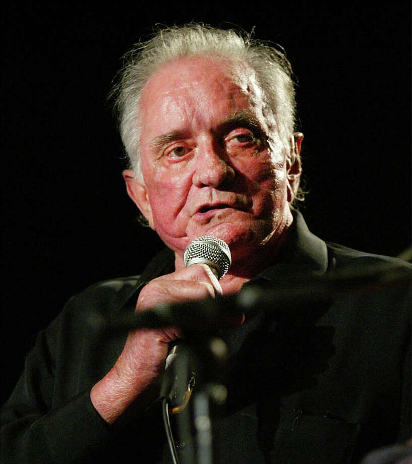 Johnny Cash performs at the first Americana Awards Show in Nashville, Tenn., on  Sept. 13, 2002. Photo: JOHN RUSSELL, AP / AP