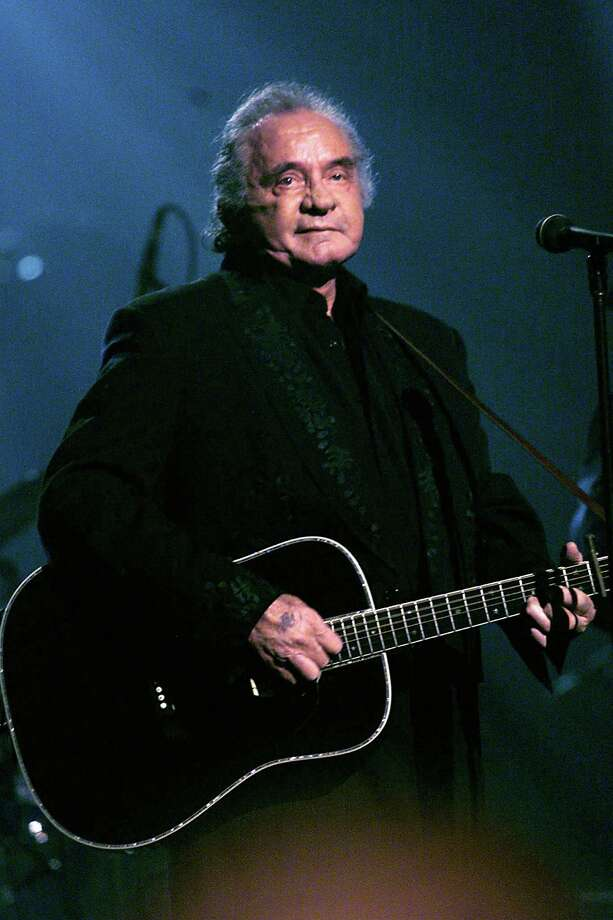 Johnny Cash performs during an all-star Tribute to Johnny Cash at the Hammerstein Ballroom in New York City in 1999. Photo: Scott Gries, Getty Images / Getty Images North America