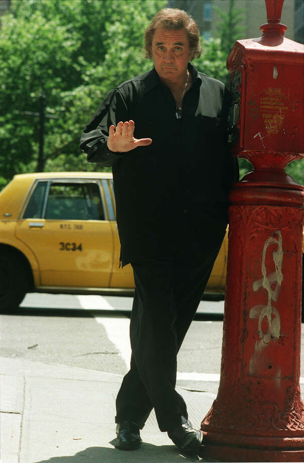 Johnny Cash poses on the sidewalk in New York in this June 3, 1994 file photo. Photo: JIM COOPER, AP / AP