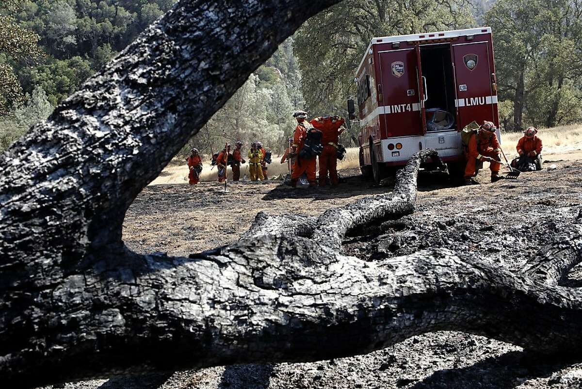 The Intermountain Fire Crew, an inmate team from Lassen and Modoc County, takes a break in Mt. Diablo State Park, on Tuesday Sept. 10, 2013, near Clayton, Calif., as firefighters near full containment of the Morgan Fire burning on the eastern slopes of Mt. Diablo State Park.