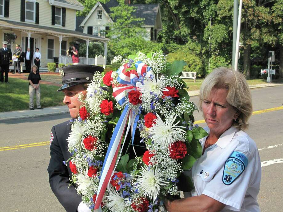 Residents, officials, members of the police and fire departments, and volunteers for the town's emergency services gathered on the lawn of Vine Cottage in New Canaan, Conn. on Wednesday, Sept. 11, 2013 for a memorial service of the attacks on 9/11/01. Photo: Tyler Woods
