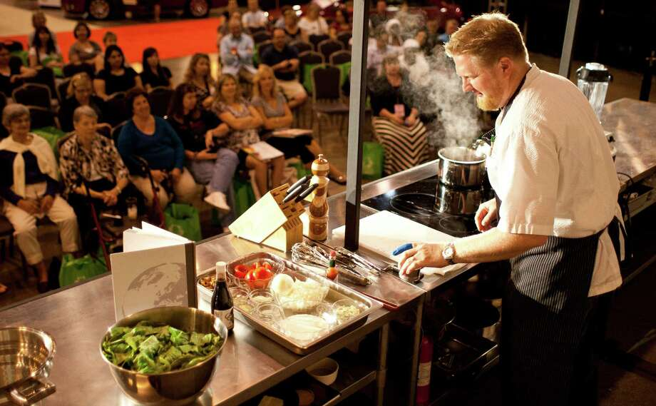 Chef Randy Evans gives a cooking demonstration during the Metropolitan Cooking & Entertaining Show last year at Reliant Center. Photo: Nick De La Torre, Staff / 2012 Houston Chronicle