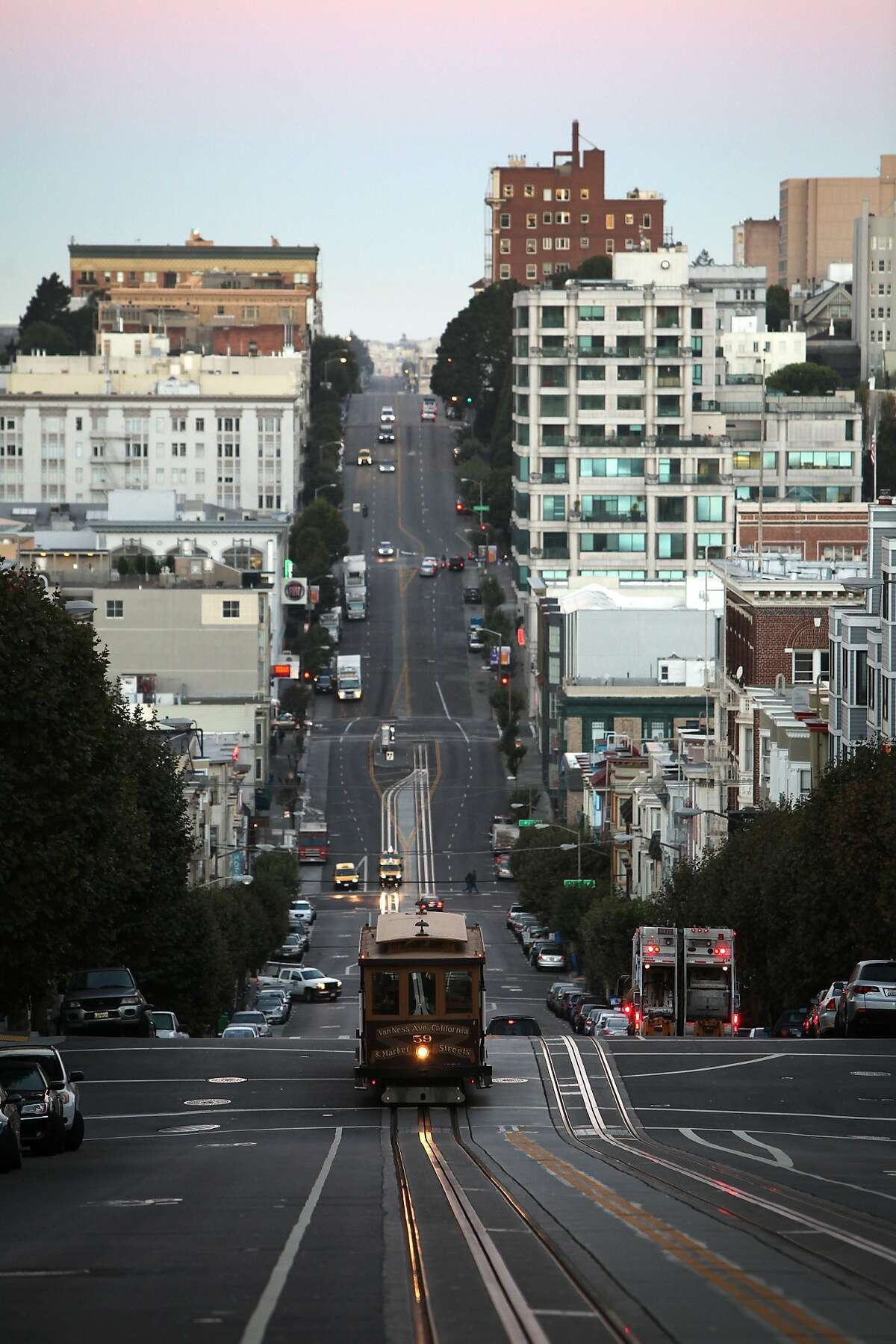 A cable car ascends Nob Hill on California Street at Leavenworth Street before sunrise on September 6, 2013 in the Nob Hill area of San Francisco, Calif.