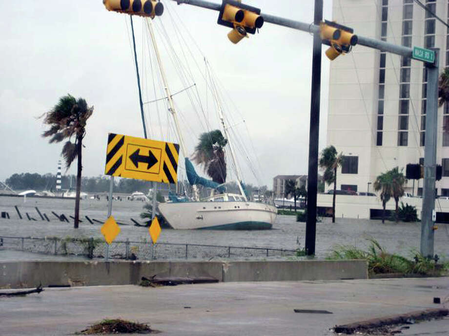 Next to the Hilton on Nasa Road One, the marina there is gone. The boat in the foreground is about 20 yards off the highway. Note all the sunken craft behind. Photo: Charles Hulvey