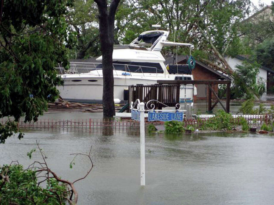The storm pushed a lot of water into the bay. Almost everything on the north side of Clear Lake was flooded. The Classic Cafe had about 6 to 7 feet of water in it when I drove by. There was a sailboat floating in the parking lot behind the cafe. All bridges on NASA One had at least one boat resting against them. Photo: Charles Hulvey