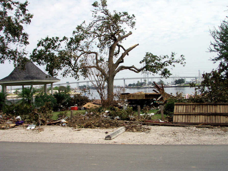 Kemah Bridge is seen in the background of this photo showing damage in Deep Hole Park. Photo: Karen Heck