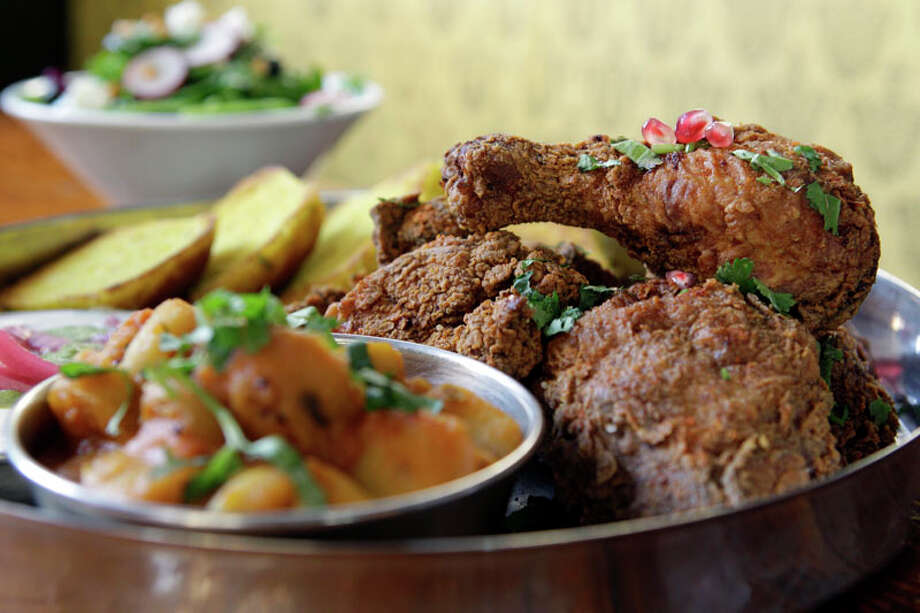 12. Pondicheri Cuisine: Indian  Dish: once-a-week special of chickpea-flour fried chicken  Entree price range: $-$$  Where: 2800 Kirby  Phone: 713-522-2022  Website:  www.pondichericafe.com   Read Alison Cook's review of Pondicheri.  Photo: Melissa Phillip, Houston Chronicle / © 2012 Houston Chronicle