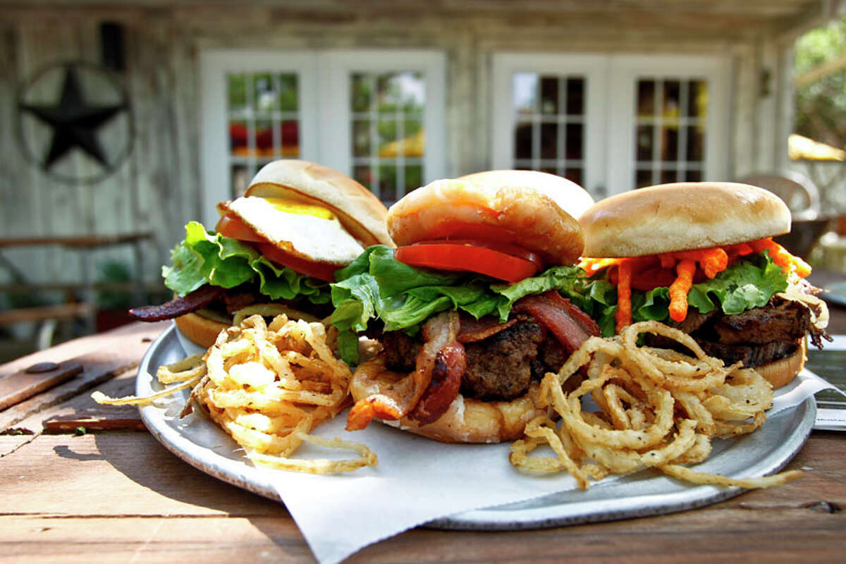 A trio of burgers at The Shack.