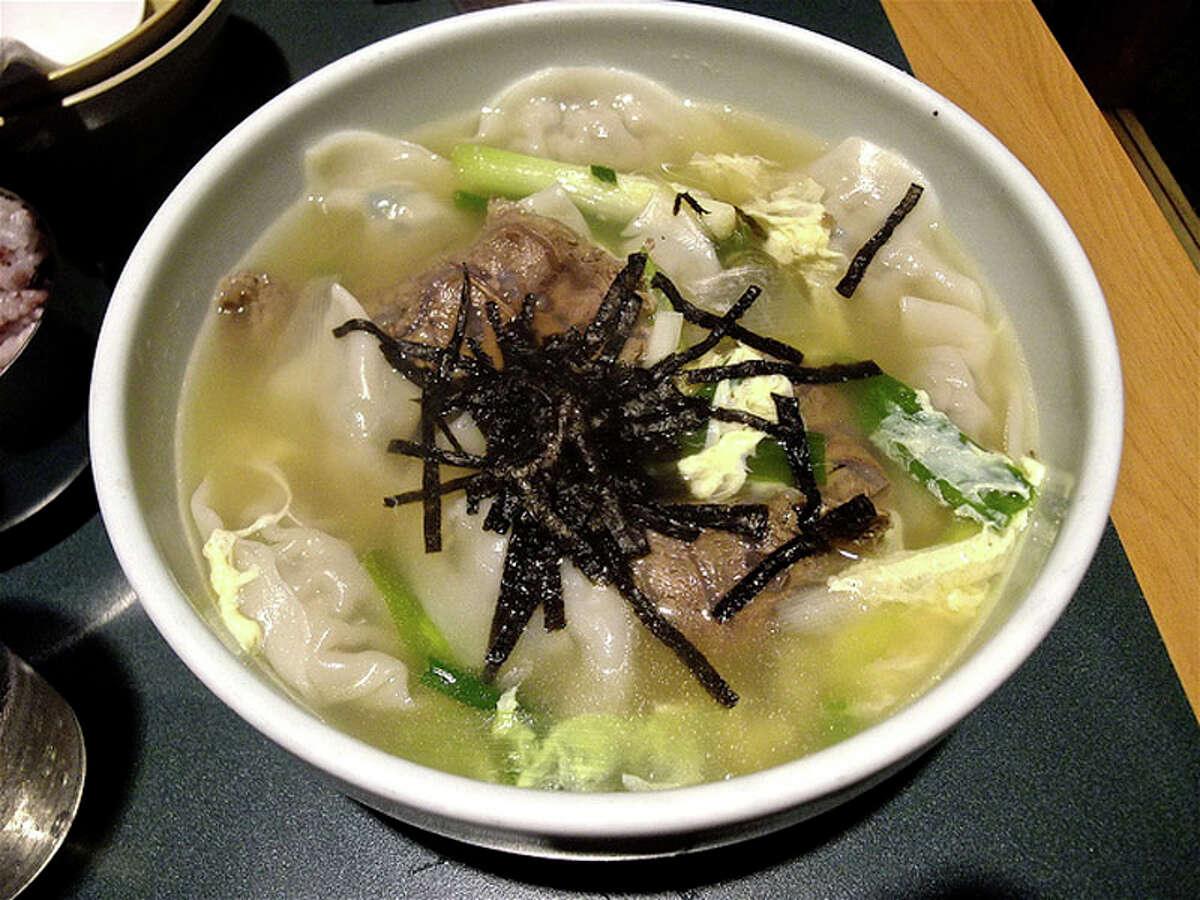 Dumpling soup with seaweed garnish