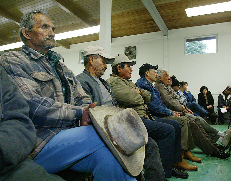 Florentino Lararios (left) listens to speakers at a meeting of former braceros and other farmworkers in Fresno, Calif. in 2004. A group representing these farmworkers, the Alianza de Exbraceros del Norte, is working to get money owed to former braceros. Photo: Associated Press File Photo