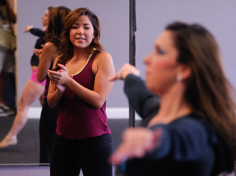 Courtney Parisi, director of the San Antonio Defenders dance team, watches participants in pre-audition workouts. Photo: Robin Jerstad / For The Express-News