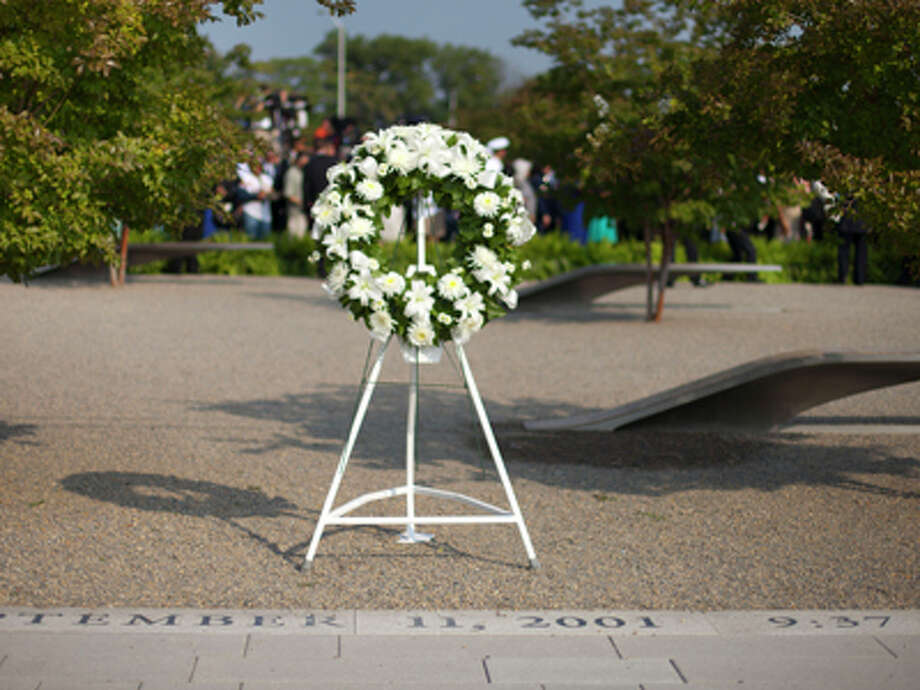 The wreath that President Barack Obama placed at the Pentagon Memorial to mark the 12th anniversary of the 9/11 attacks is seen on Wednesday, Sept. 11, 2013, at the Pentagon. Photo: Pablo Martinez Monsivais, AP / AP