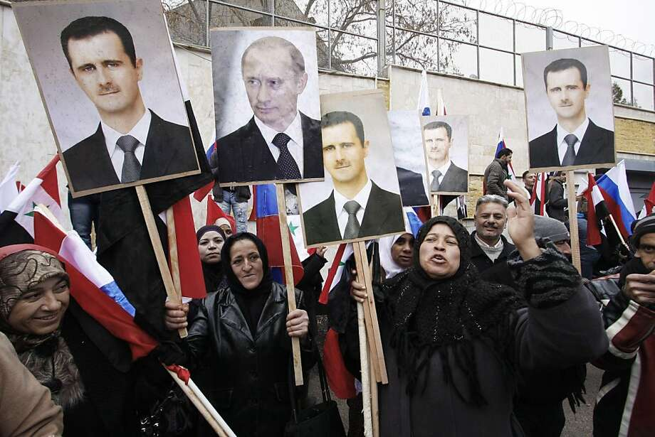 Demonstrators hold photos of Syrian President Bashar Assad and his ally, Russian President Vladimir Putin, at a rally in Damascus, Syria, last year. Photo: Muzaffar Salman, Associated Press